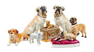 * A Group of Seven Porcelain and Ceramic Mastiff Figures Height 9 1/4 inches.
