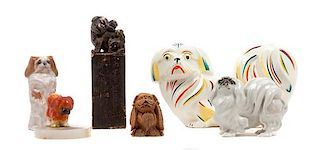 * A Group of Six Pekingese Figures Width of widest 9 1/2 inches.