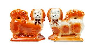 * A Pair of Staffordshire Pekingese Figures Width 8 1/2 inches.