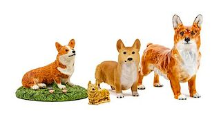 * A Group of Four Pembroke Welsh Corgi Figures Width of widest 5 3/4 inches.