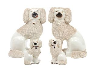 * A Group of Four Staffordshire Poodles Height of tallest 9 3/4 inches.