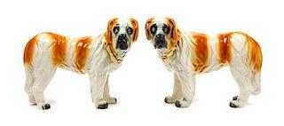* A Pair of Staffordshire Saint Bernard Figures Width of each 13 inches.