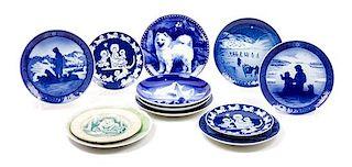 * Twelve Porcelain Samoyed Plates Diameter of largest 7 3/4 inches.