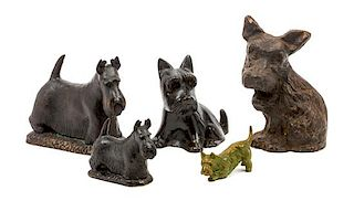 * Five Scottish Terrier Sculptures Height of tallest 7 3/4 inches.