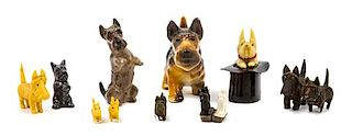 * Eleven Scottish Terrier Figures Width of widest 4 1/4 inches.
