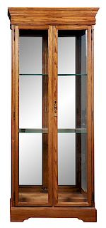 * Three Wood and Glass Cases Height 79 inches.