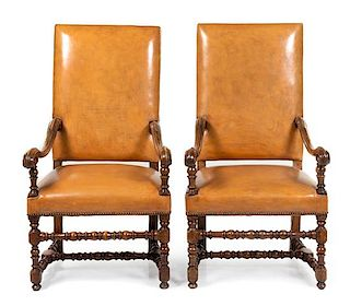 A Pair of Louis XIV Walnut Armchairs Height 48 inches.