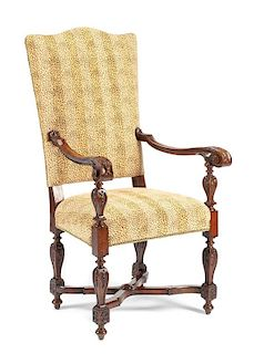 A Louis XIV Style Carved Armchair Height 53 x width 30 x depth 26 inches.