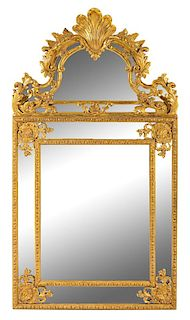 A Regence Giltwood Mirror Height 66 x width 36 inches.