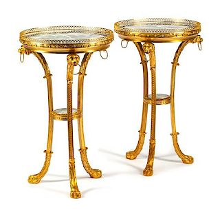 A Pair of Regence Style Gilt Bronze and Marble Tables Height 31 x diameter of top 18 1/2 inches.