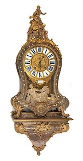 A French Boulle Marquetry Bracket Clock and Bracket Height of clock 32 inches; height of bracket 13 inches.