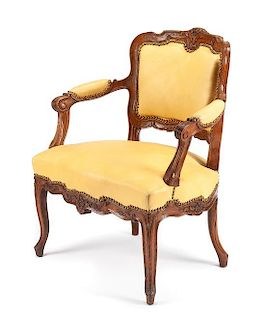 A French Provincial Oak Fauteuil Height 33 3/4 inches.