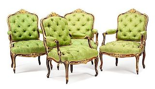 A Set of Four Louis XV Style Parcel Gilt Fauteuils Height 39 inches.