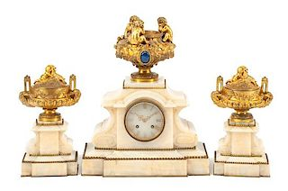 A French Gilt Bronze and Marble Clock Garniture Height of mantel clock 21 inches.