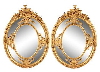A Pair of Large Louis XV Style Giltwood and Gesso Mirrors Height 73 1/2 x width 53 inches.
