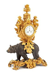 A Louis XV Style Gilt and Patinated Bronze Figural Clock Height 29 1/4 inches.