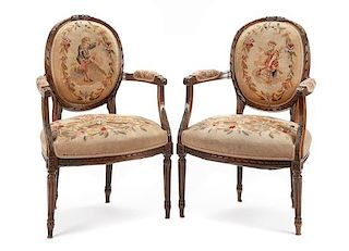A Pair of Louis XV Style Walnut Fauteuils Height 35 inches.