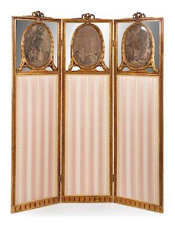A Louis XVI Giltwood Three-Fold Dressing Screen Height 68 x width of each panel 18 5/8 inches.