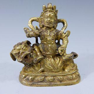 SMALL SINO TIBETAN GILT BRONZE BUDDHA RIDING LION- 17/18TH CENTURY