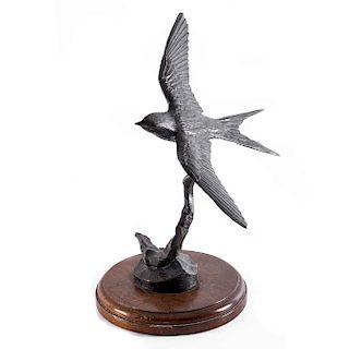 Alejandro Fuentes Gil, Viajera. Fundición en bronce patinado con base de madera circular. Firmada y fechada 1993.