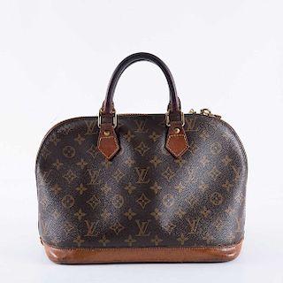 Bolso de mano. Francia, siglo XX. De la marca Louis Vuitton. Elaborado en piel y lona. Número de serie: SD0021.