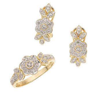 Juego de anillo y par de aretes con diamantes en oro amarillo de 14 k Con diamantes en vistas blancas. Talla anillo: 7...