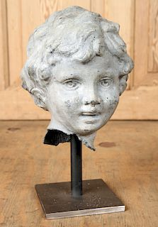 PETITE ZINC SCULPTURE OF CHILD'S HEAD ON STAND