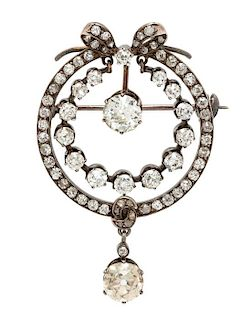 A Victorian Silver Topped Yellow Gold and Diamond Pendant/Brooch, 5.50 dwts.