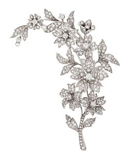 A White Gold and Diamond Floral Spray Brooch, 20.30 dwts.