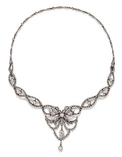 A Belle Epoque Silver Topped 18 Karat Yellow and Diamond Festoon Necklace, French, 22.40 dwts.