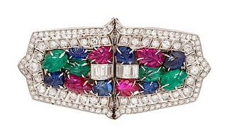 A Pair of Art Deco Platinum, Diamond, Ruby, Sapphire, and Emerald Double Clip Brooches, 23.40 dwts.