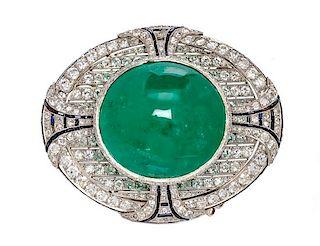 An Art Deco Platinum, Emerald, Diamond and Onyx Brooch, 49.90 dwts.