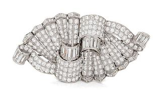 A Pair of Platinum, White Gold and Diamond Brooches, 27.20 dwts.