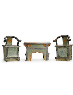 A Chinese miniature table and two  armchairs