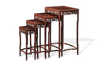 A set of Chinese carved hardwood quartetto tables