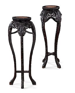 A pair of Chinese carved hardwood plant stands