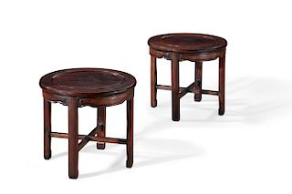 A pair of Chinese carved hardwood low tables