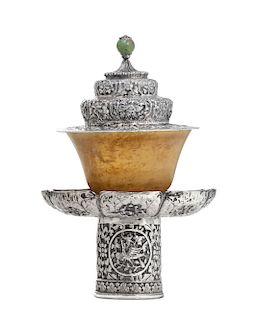 A Tibetan silver covered stand