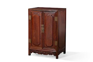 A Chinese carved hardwood side cupboard