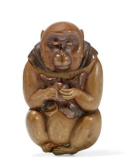 A Japanese monkey form match safe/flint strike