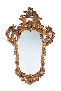 An Italian Baroque style carved giltwood mirror