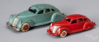 Two Hubley cast iron sedans
