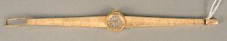 Omega 14 karat gold ladies wristwatch with 14 karat gold bracelet. lg. 6 1/2 in., 27.7 grams total weight