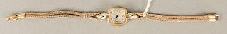 Hamilton 14 karat gold ladies wristwatch with 14 karat gold bracelet. lg. 6 3/4 in., 14.2 grams total weight