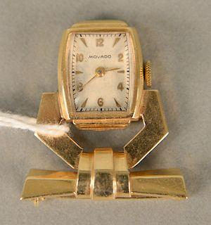 Movado ladies 14 karat gold lapel watch. 12.7 grams total weight