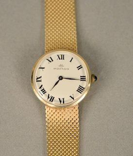 Movado 14 karat gold ladies wristwatch with 14 karat gold mesh bracelet. lg. 7 in., 36.9 grams total weight
