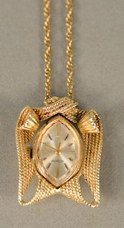 LeCoultre ladies 14 karat gold pendant watch on 14 karat gold chain. chain lg. 24 in., 16.9 grams total weight