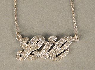 14 karat white gold chain with Lil pendant, set with diamonds.