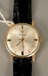 Jules Jurgensen Automatic mens wristwatch in gold filled case with leather band.