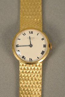 Universal 18 karat yellow gold ladies wristwatch with 18 karat mesh bracelet. lg. 7 1/8 in., 43 grams total weight